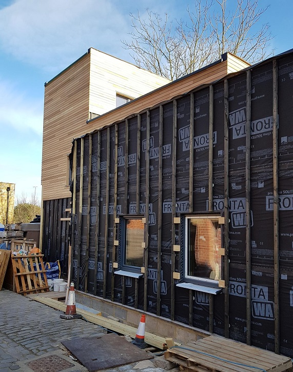 TImber cladding in progress