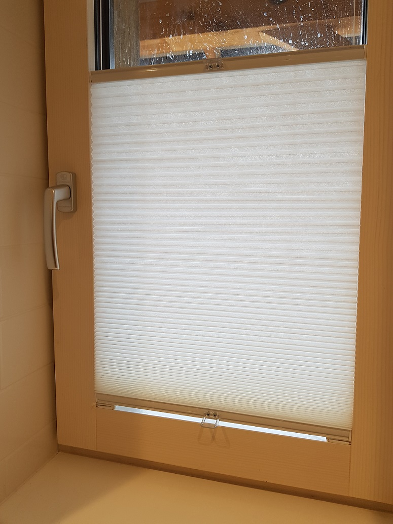 Internal blind set within the window frame