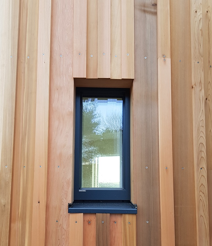 PH15 window in vertical cedar cladding